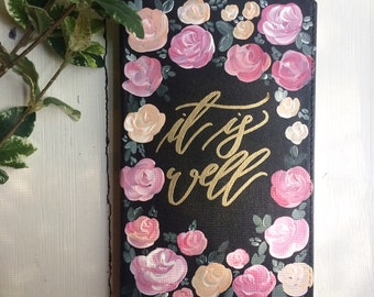 "Pink, black, and gold ""It is Well"" hardcover notebook"