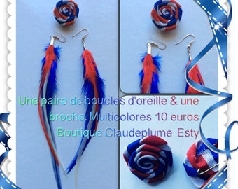 A pair of earrings light feather & flower buttonhole