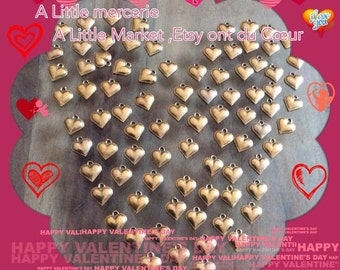 Lot of 100 heart pendants patina old gold