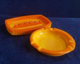 Pair of bright orange slag glass retro ashtrays