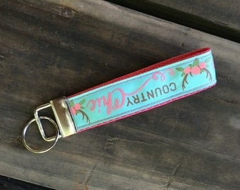Country chic teal and pink wristlet
