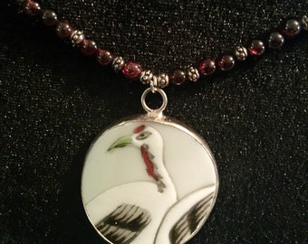 Genuine garnet crane porcelain shard necklace