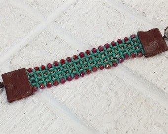 Handwoven cuff bracelet with turquoise ,brown and red  bead combination.  Button closure & leather trim. Sundance inspired