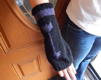 Knitted arm warmers, black and purple with Hawkeye-themed arrow design