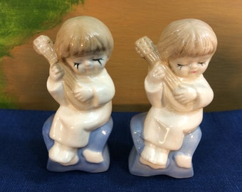 Vintage Porcelain Figurines Pair Of Little Boys Sitting On Stars Playing A Lute