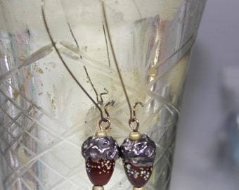 Brown acorn lampwork bead with antique bronze component