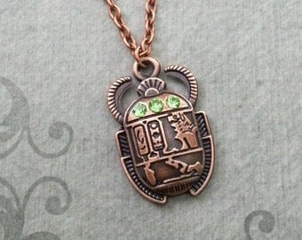 Scarab Beetle Necklace Scarab Jewelry Green Eyed Scarab Charm Necklace Copper Scarab Pendant Necklace Egyptian Jewelry Hieroglyphic Necklace