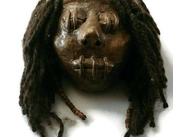 Polymer clay, shrunken head, replica shrunken head, clay shrunken head, polymer clay sculpture, tribal replica, polymer clay shrunken head