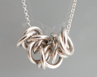 long loops silver necklace with pendant
