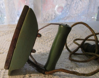 """Travel Iron 1930s, Electrical Green Granite Ware, Wood Handle, Light Socket Adapter, Handle Plate Reads """"Buster Brown Shoe"""""""