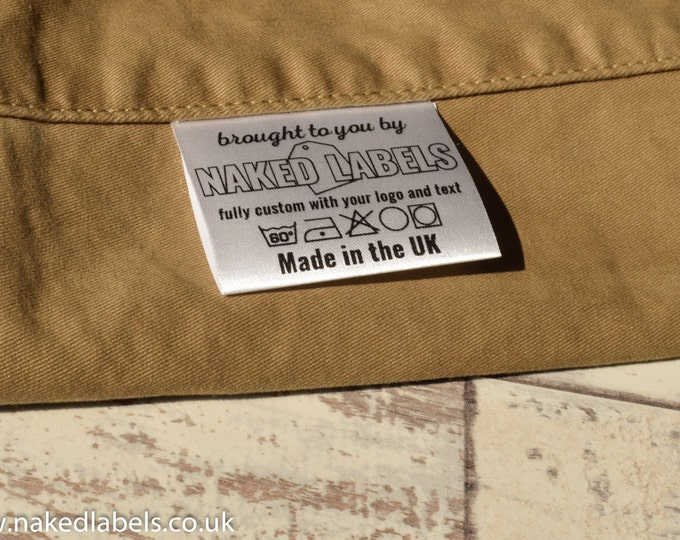 custom stickers and custom clothing labels hang by nakedlabe