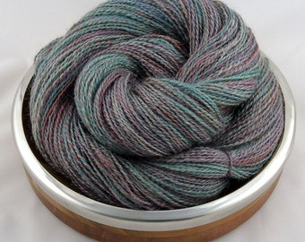 Hand spun yarn, 70/30% Teeswater/Silk, Sport weight in muted teal, blue and red