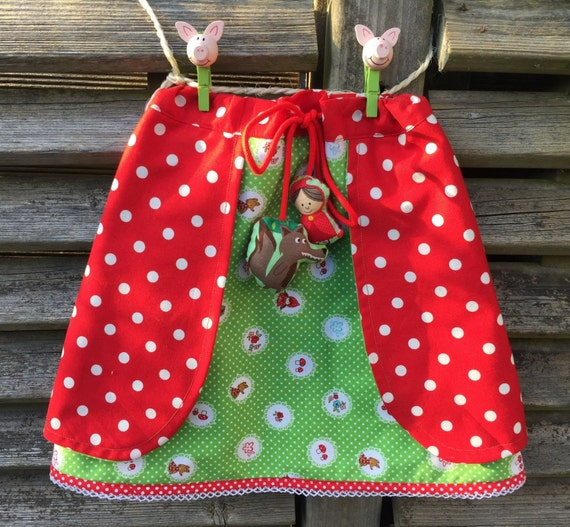 Red riding hood a-line girls skirt. With red and white polka dots, the cord has matching stoppers.