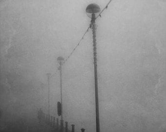 Down on the waterfront. A dark, eerie fine art photographic giclée print of a shadowy figure emerging from the fog on Ipswich waterfront.