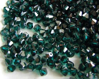 Swarovski Crystal Bicone Beads 5328 Emerald Satin 4mm. Swarovski Crystal Beads, 4mm Green Beads