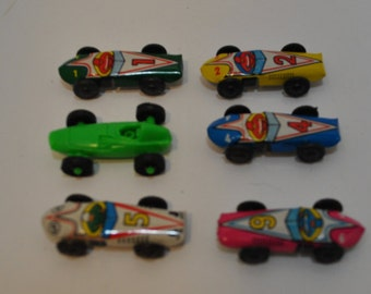 Five Vintage miniature tin toy  race cars and a vintage plastic race car