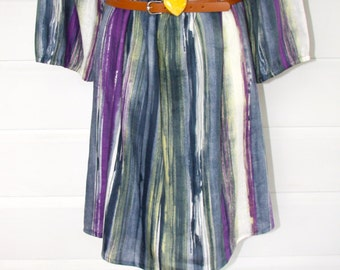 Linen dress with leather belt.