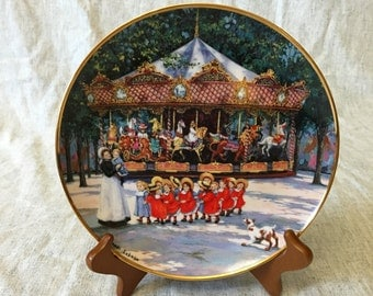 """Franklin Mint Collectors Plate """" Carousel Holiday"""" by Sandi Lebron"""