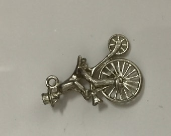 Silver vintage charm of man on a bicycle