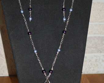 Purple glass pendant necklace with matching earrings
