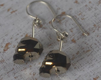Head on a stake earrings - Genuine Swarovski skull beads with silver filled findings