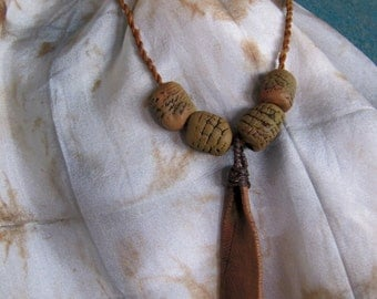 earthy emu feather pendant pit fired ceramic necklace