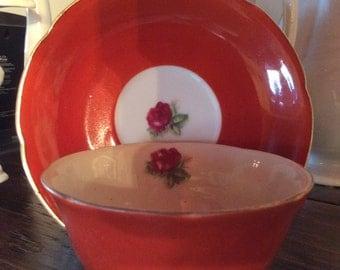 Vintage Occupied Japan porcelain cup and saucer rust orange color 1945- 1952
