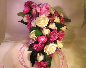 Asymmetrical Silk  bridal bouquet with pink and white roses, cerise daisys and pink runnunculus.