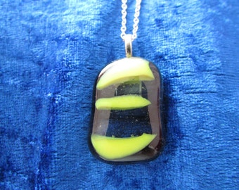 black and yellow fused glass pendant