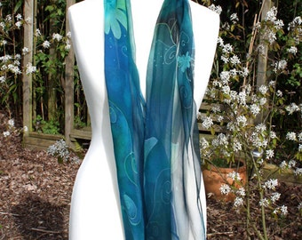 Silk scarf of chiffon. Green flowers on blue. Handpainted.