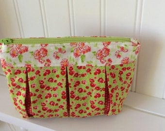 Bright green and red zippered pouch