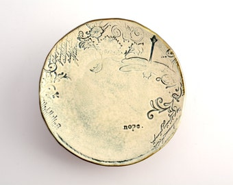 small plate/saucer with nope and dragonfly stamps