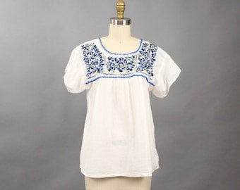 vintage white cotton gauze peasant blouse . blue flowers embroidered peasant blouse . boho flowy top, xs small