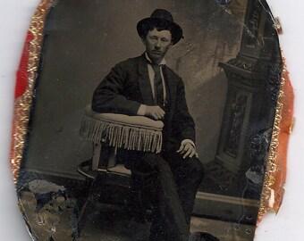Man in hat photographer chair tintype background antique photo civil war era
