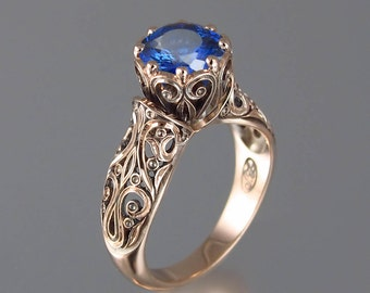 The ENCHANTED PRINCESS 14k rose gold engagement ring with Blue Sapphire