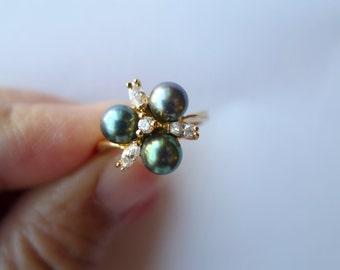 Sophia . Black Cultured pearl ring . size 7 . GP 14K