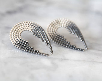 Cascade. Silver statement earrings.