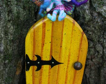 Enchanting Purple and Pink Faerie Door Garden Ornament for your tree trunk