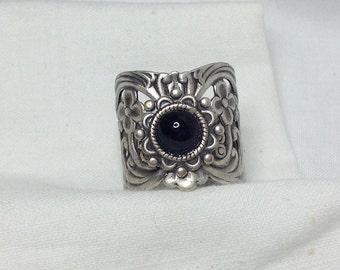 oO EBONY Oo black cab silver ring