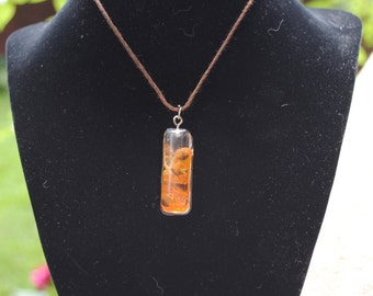 Rectangle resin pendant with real orange flower