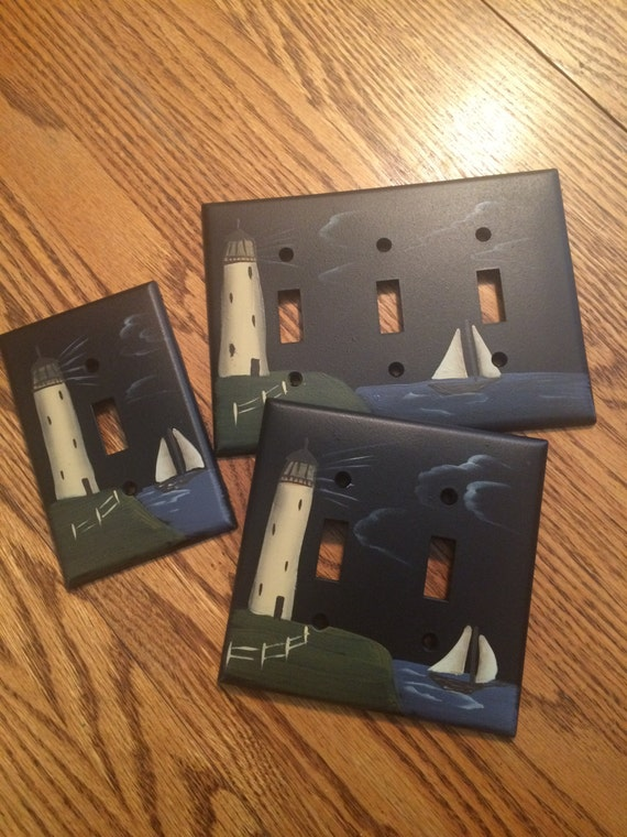 Primitive lighthouse sailboat switchplate by for Lighthouse switch plates