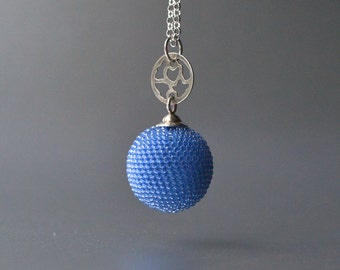 blue beaded pendant necklace, silver ornament, blue globe, blue sphere