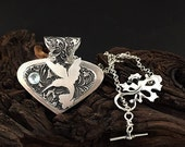 Humming bird Gardens Sterling Silver,  custom necklace with Swiss Blue Topaz SRA