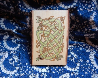 Rustic wooden pyrographic Celtic knotwork dragons plaque. Book of Kells