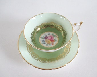 Tea Cup and Saucer Paragon Gold Gilt Hand Painted Bouquets