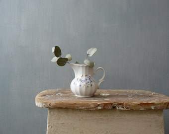 Vintage teapot. White porcelain teapot. Tiny flowers china teapot