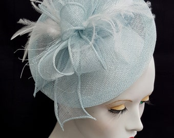 Pale blue powder blue baby blue saucer tilt sinamay fascinator with white feather detail - headband fixing