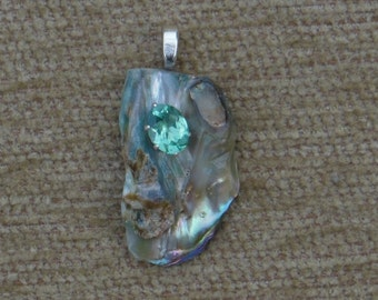 Abalone shell and bluegreen apatite pendant with sterling silver chain.