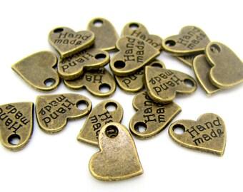 "Bronze Charms : 25 Antique Bronze Heart ""Handmade"" Charms | ""Handmade"" Heart Pendants 9x9mm -- Lead, Nickel & Cadmium Free 19868.H3I"