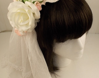 White and Pink Veil Hair Accessory